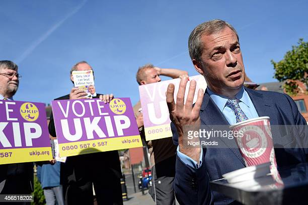 Ukip party leader Nigel Farage campaigns for the Heywood and Middleton byelection candidate John Bickley on October 2 2014 in Middleton England The...