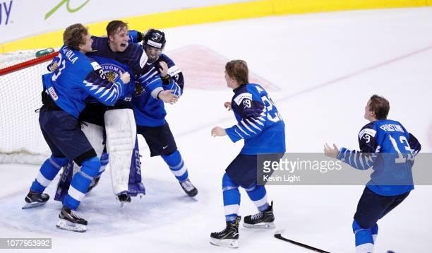 Ukko-Pekka Luukkonen of Finland celebrates with teammates Otto Latvala, Toni Utunen, Anton Lundell and Valtteri Puustinen following a gold medal game...