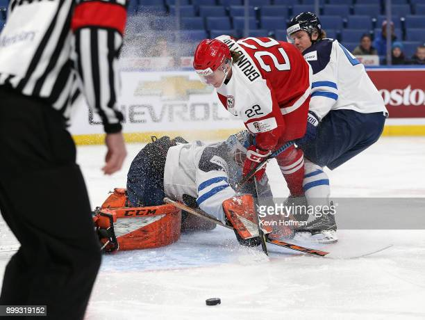 UkkoPekka Luukkonen of Finland makes the save against Andreas Grundtvig of Denmark in the first period during the IIHF World Junior Championship at...