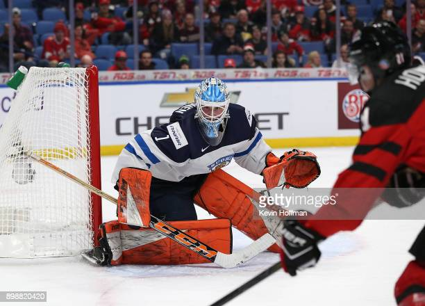 UkkoPekka Luukkonen of Finland tends net as Brett Howden of Canada skates by with the puck during the first period at KeyBank Center on December 26...