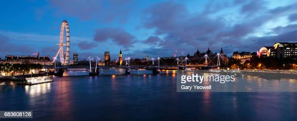 UK,London,London skyline illuminated at dusk