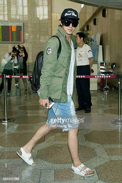 Know of South Korean boy band TVXQ is seen on departure at Gimpo International Airport on August 29 2014 in Seoul South Korea
