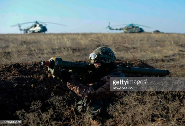 TOPSHOT Ukrainain seviceman attends a military drills near Urzuf village not far from the city of Mariupol eastern Ukraine on November 29 2018...