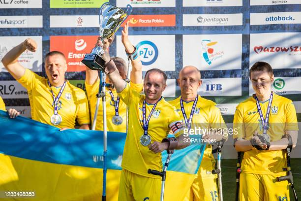 Ukraine amputee football team celebrate a second place during during AMP Futbol Cup 2021 ceremony after match between Poland and Ukraine at OSiR...