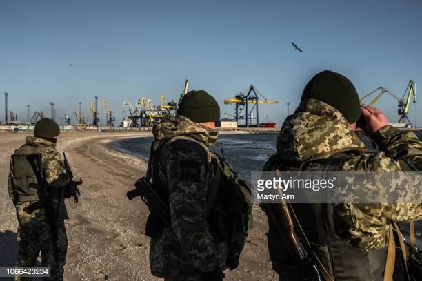 Ukraine Border Security Force soldiers patrol the coast of the Azov Sea near Mariupol Port as President Poroshenko declares martial law in response...