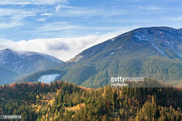 ukraine, carpathians. time lapse of morning fog in the autumn mountains. landscape with snowy mountains and running mist. - ukraine stock pictures, royalty-free photos & images