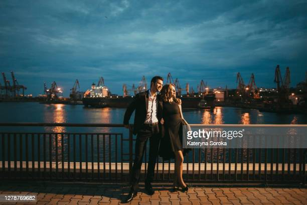 ukraine, couple on date at waterfront - ukraine stock pictures, royalty-free photos & images