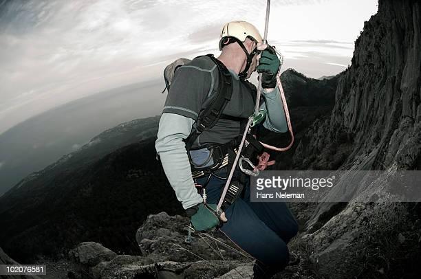 Ukraine, Crimea, Alupka, Alupkinskaya wall, climber moving down on rope