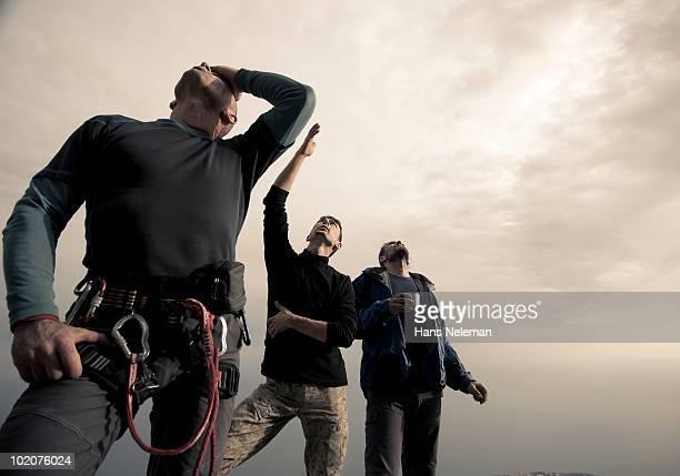 Ukraine, Crimea, Alupka, Alupkinskaya wall, three climbers discussing