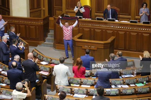 TOPSHOT Ukraine football federation chief and lawmaker Andriy Pavelko wearing Tshirt of the Croation football team holds a scarf with the sign...