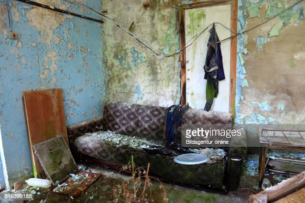 Ukraine In the Restricted and Uninhabitable 30 Kilometer Zone Around the Chernobyl Power Plant and the Pripyat Labor Camp Sofa In A Room