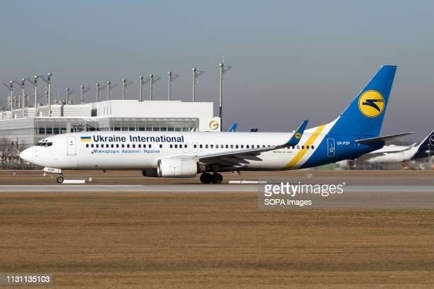 Ukraine International Airlines Boeing 737800 seen on the runway at Munich airport