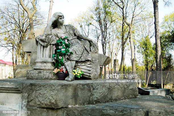 Ukraine, Lvov, Lychakiv Cemetery with impressive sculpture and tomb
