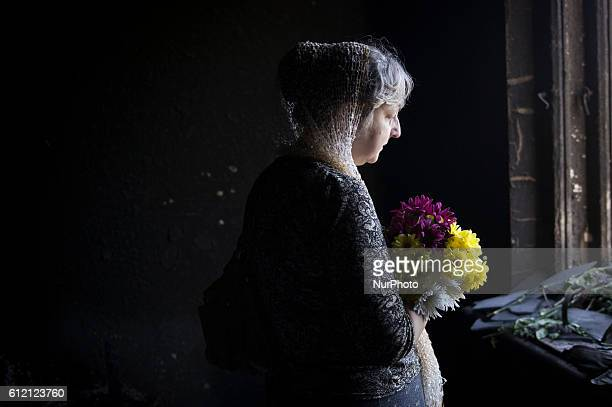 Unidentified woman mourns inside the burnt trade union building in Odessa, Ukraine, May 8, 2014. More than 40 people died in the riots, which some...
