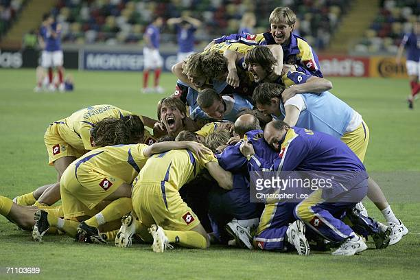Ukraine players celebrate their victory after penalties as they jump on goalkeeper Olexandr Rybka during the UEFA U21's Championship 2006 Semi Final...