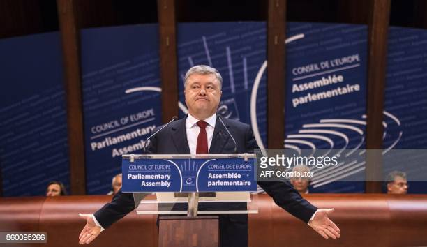 Ukraine President Petro Poroshenko delivers a speech to the Council of Europe parliamentary assembly in Strasbourg, eastern France, on October 11,...