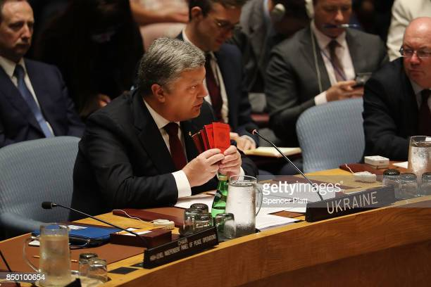 Ukraine President Petro Poroshenko holds up what he claimed are confiscated Russian passports during a Security Council meeting at the 72nd United...