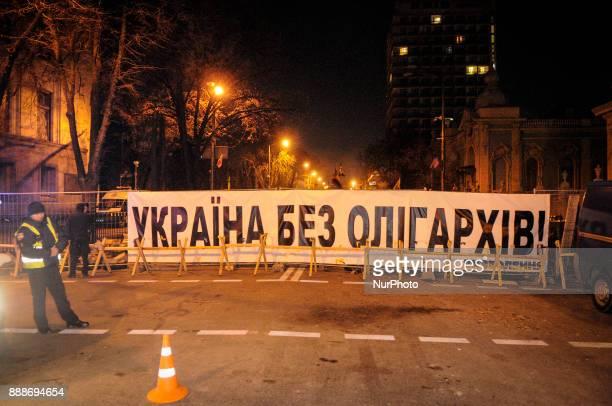 Ukraine without oligarchs is seen on a banner near the Verkhovna Rada the Ukrainian parliament in Kiev Ukraine on December 9 2017
