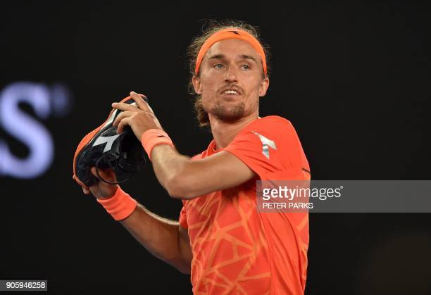 Ukraine's Alexandr Dolgopolov Jr throws his shoes into the crowd after beating Australia's Matthew Ebden in their men's singles second round match on...