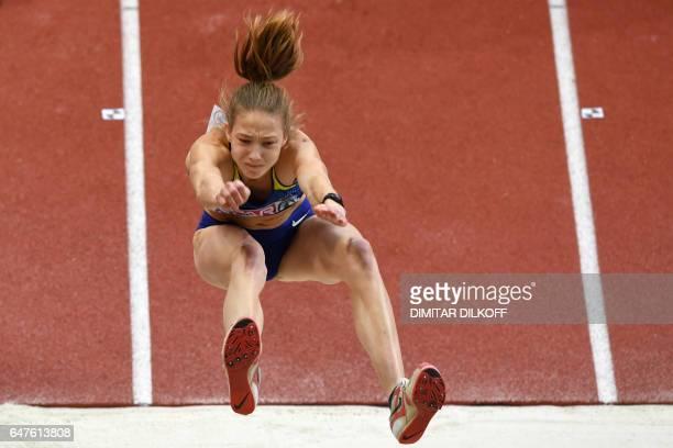 Ukraine's Alina Shukh competes in the women's pentathlon long jump at the 2017 European Athletics Indoor Championships in Belgrade on March 3 2017 /...