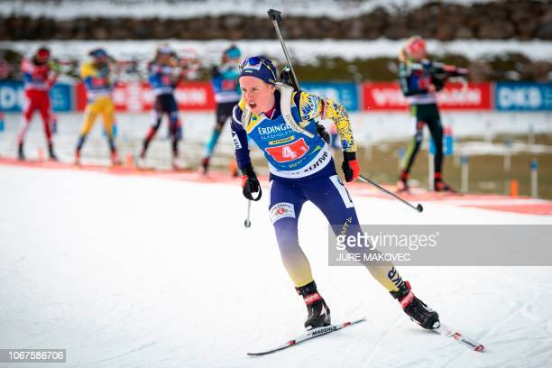 Ukraine's Anastasiya Merkushyna competes as she leaves the shooting range during the Single Mixed Relay competition of the IBU Biathlon World Cup in...