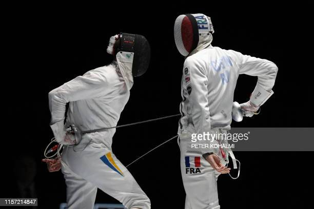 Ukraine's Anatolii Herey and France's Ronan Gustin compete in the Men's Epee team final at the 2019 Fencing World Championships in Budapest Hungary...
