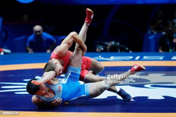 Ukraine s Andrii Yatsenko competes against North Korea s Hakjin Jong during  the men s freestyle wrestling Seniors 57kg 775ec941d09d8
