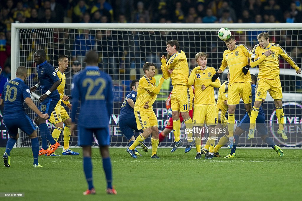Ukraine's Andriy Yarmolenko (2nd R) blocks shoot of Karim Benzema (L) of France during the FIFA 2014 World Cup Qualifier Play-off First Leg soccer match between Ukraine and France at the Olympic Stadium on November 15, 2013 in Kiev, Ukraine.
