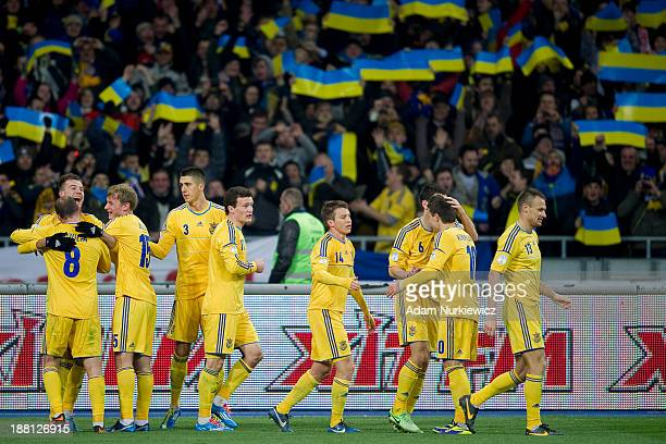 Ukraine's Andriy Yarmolenko celebrates with teammates after scoring the second goal during the FIFA 2014 World Cup Qualifier Playoff First Leg soccer...