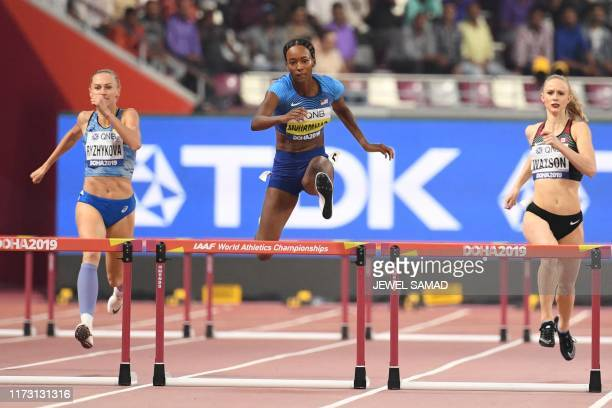 Ukraine's Anna Ryzhykova , USA's Dalilah Muhammad and Canada's Sage Watson compete in the Women's 400m hurdles semi-final at the 2019 IAAF Athletics...