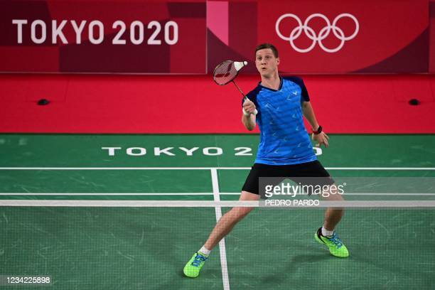 Ukraine's Artem Pochtarov hits a shot to France's Brice Leverdez in their men's singles badminton group stage match during the Tokyo 2020 Olympic...