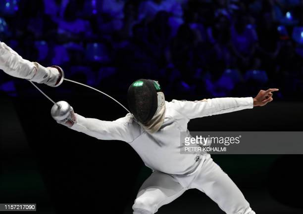 Ukraine's Bogdan Nikishin and France's Daniel Jerent compete in the Men's Epee team final at the 2019 Fencing World Championships in Budapest Hungary...