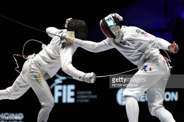 Ukraine's Bogdan Nikishin and France's Yannick Borel compete in the Men's Epee team final at the 2019 Fencing World Championships in Budapest Hungary...