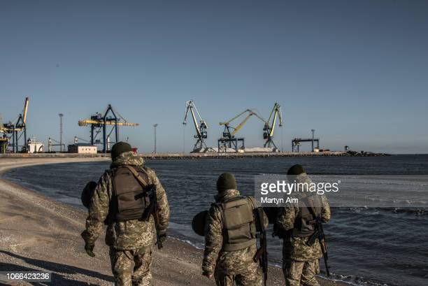Ukraine's Border Security Force soldiers patrol the coast of the Azov Sea near Mariupol Port as President Poroshenko declares martial law in response...