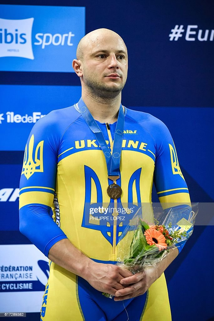 Ukraine's bronze medalist Andriy Vynokurov looks on from the podium of the men's sprint race at the European Track Championships in Saint-Quentin-en-Yvelines on October 22, 2016. / AFP / PHILIPPE