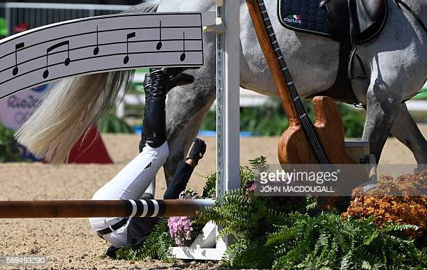 Ukraine's Cassio Rivetti on Fine Fleur du Marais falls off his horse during the Equestrian's Show Jumping first qualifier event of the 2016 Rio...
