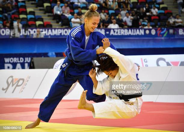 Ukraine's Daria Bilodid fights to win the gold medal against Japan's Funa Tonaki during the under 48kg women category of the 2018 Judo World...