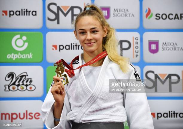 Ukraine's Daria Bilodid poses with her gold medal after winning in the under 48kg women category of the 2018 Judo World Championships in Baku on...