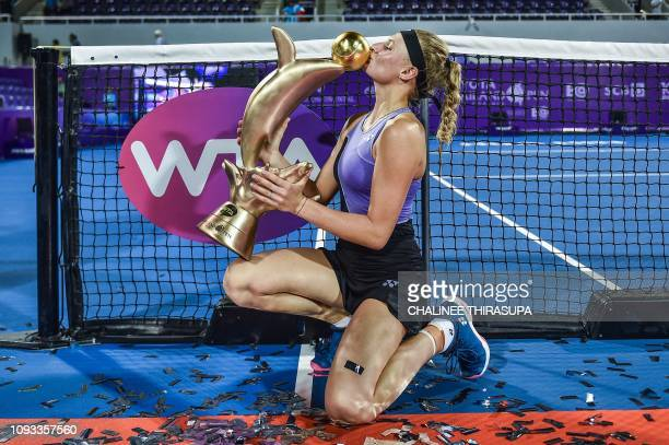 TOPSHOT Ukraine's Dayana Yastremska poses with her winning trophy during presentation ceremony after defeating Australia's Ajla Tomljanovic in the...