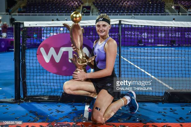 Ukraine's Dayana Yastremska poses with her winning trophy during presentation ceremony after defeating Australia's Ajla Tomljanovic in the final of...