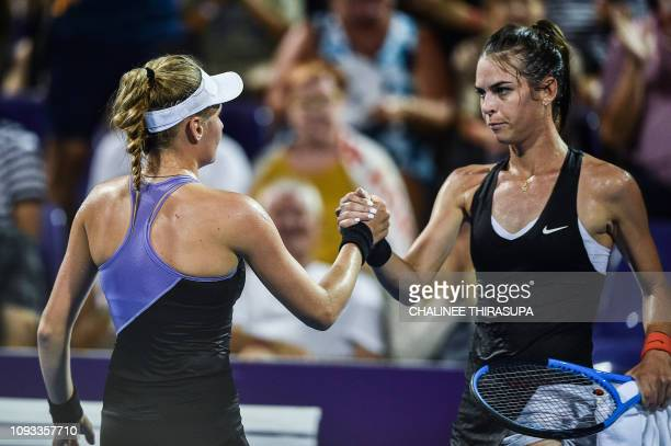 Ukraine's Dayana Yastremska shakes hands with with Australia's Ajla Tomljanovic during the final of the WTA Thailand Open tennis tournament in Hua...