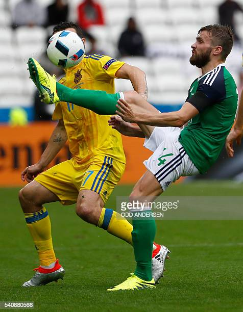 Ukraine's defender Artem Fedetskiy and Northern Ireland's midfielder Stuart Dallas vie for the ball during the Euro 2016 group C football match...