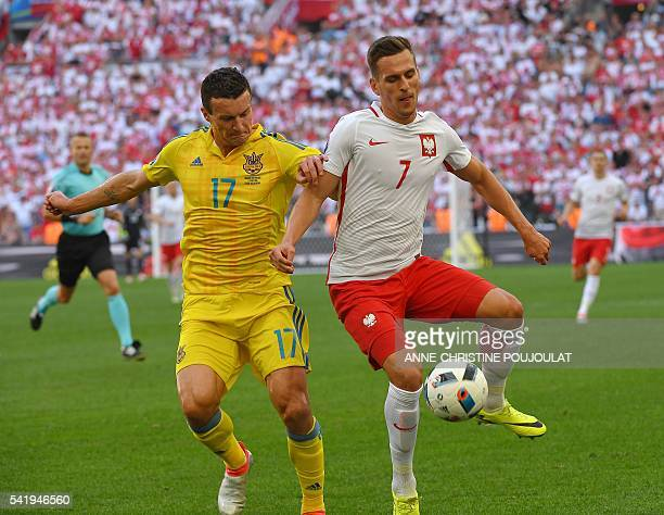 Ukraine's defender Artem Fedetskiy vies with Poland's forward Arkadiusz Milik during the Euro 2016 group C football match between Ukraine and Poland...