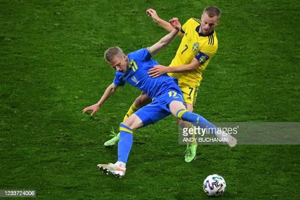 Ukraine's defender Oleksandr Zinchenko fights for the ball with Sweden's midfielder Sebastian Larsson during the UEFA EURO 2020 round of 16 football...