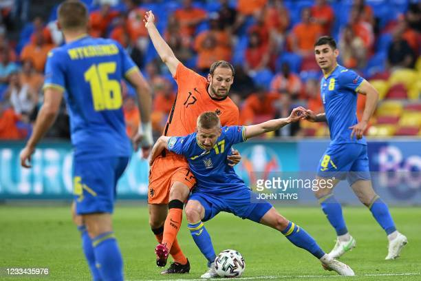 Ukraine's defender Oleksandr Zinchenko vies for the ball with Netherlands' defender Daley Blind during the UEFA EURO 2020 Group C football match...