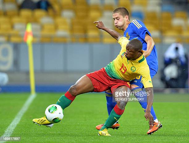 Ukraine's defender Yaroslav Rakytskiy vies for the ball with Cameroon's forward Paul Alo'o Efoulou of during their friendly football match in Kiev on...
