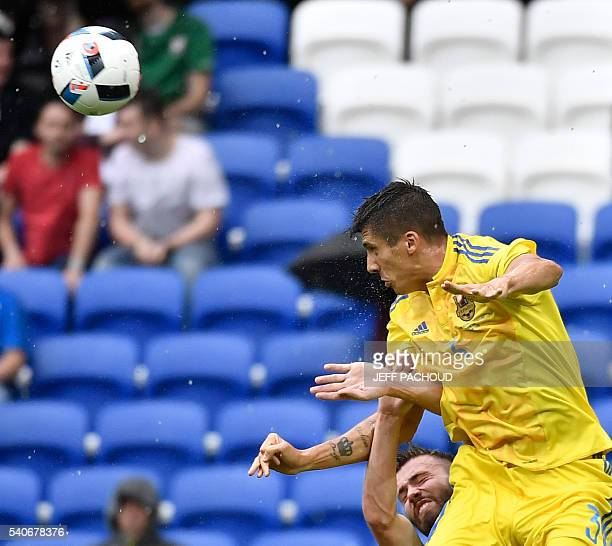 Ukraine's defender Yevhen Khacheridi and Northern Ireland's midfielder Stuart Dallas vie for the ball during the Euro 2016 group C football match...