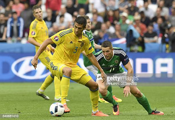 Ukraine's defender Yevhen Khacheridi vies with Northern Ireland's forward Conor Washington during the Euro 2016 group C football match between...
