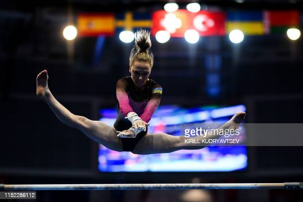 Ukraine's Diana Varinska competes in the uneven bars event of the women's allaround qualification of the Artistic Gymnastics at the 2019 European...