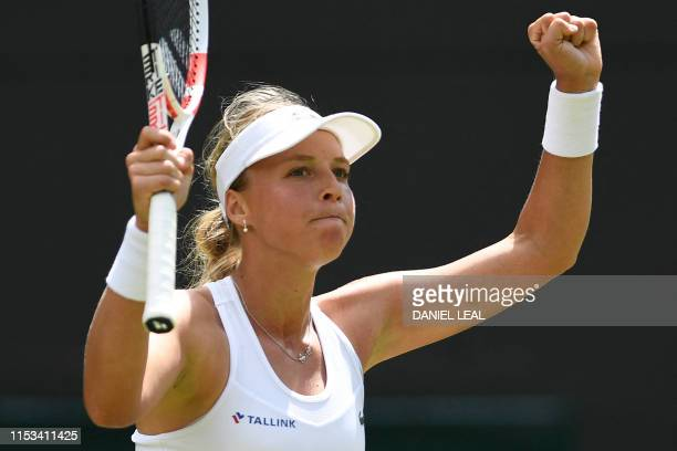 Ukraine's Elina Svitolina celebrates after beating Britain's Heather Watson during their women's singles second round match on the third day of the...